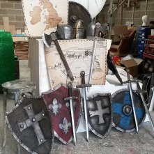Swords, sheilds and axes , all made from mdf and foamex. The helmets were bought childrens toys that were painted and distressed .