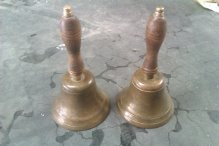 One real handbell and one soft one